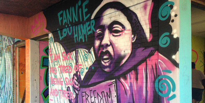 "Colorful mural of civil rights leader Fannie Lou Hamer holding an umbrella, featuring the quote ""I am sick and tired of being sick and tired"""