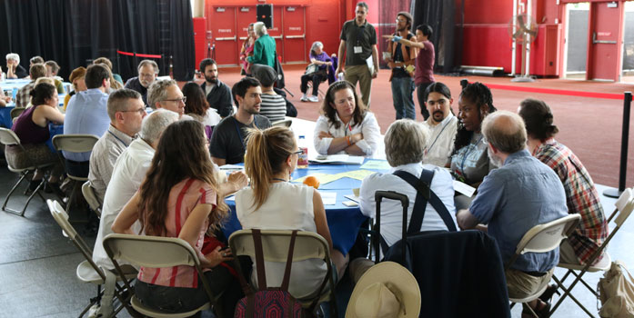 Group at CommonBound 2014 sitting around the table engaging in coversation